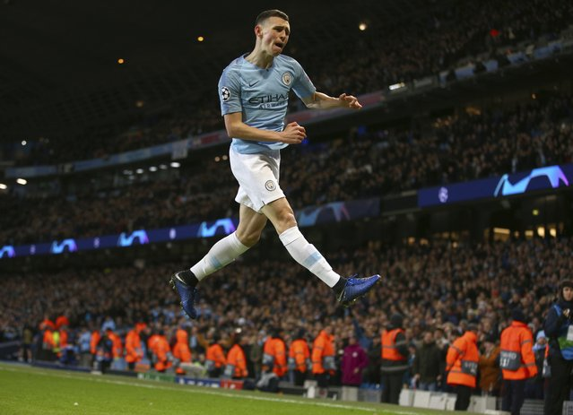 Manchester City's Phil Foden celebrates after scoring his side's sixth goal during the Champions League round of 16 second leg, soccer match between Manchester City and Schalke 04 at Etihad stadium in Manchester, England, Tuesday, March 12, 2019. (Photo by Dave Thompson/AP Photo)