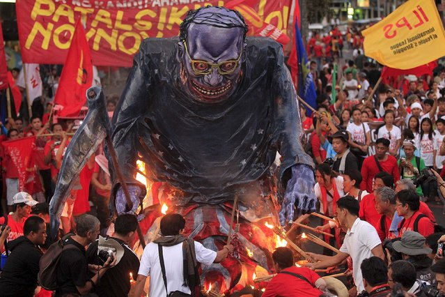 Workers burned an effigy of Philippine President Benigno Aquino during a May Day protest outside the presidential palace in Manila May 1, 2015. (Photo by Romeo Ranoco/Reuters)