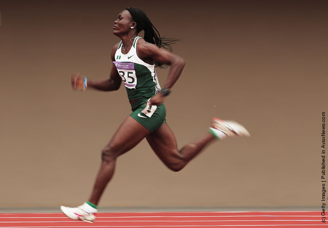 Josephine Omaka of Nigeria in action during the first round of the Girls 100m on day four of the Youth Olympics at Bishan Stadium on August 18, 2010 in Singapore