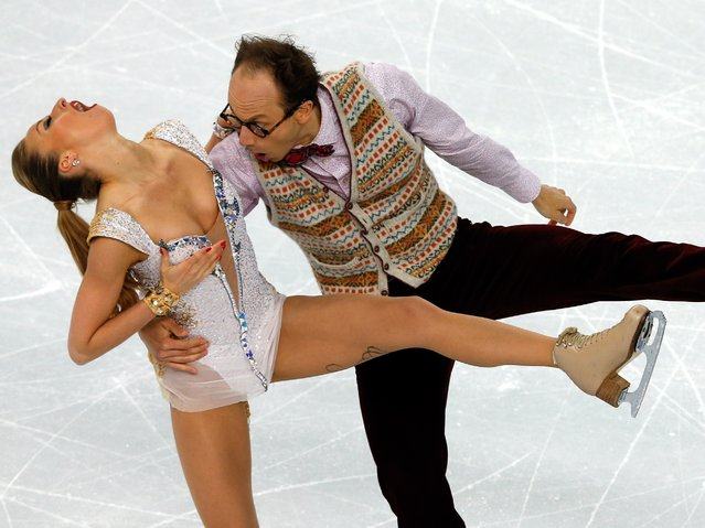 Germany's Alexander Gazsi and Germany's Nelli Zhiganshina perform in the Figure Skating Ice Dance Short Dance at the Iceberg Skating Palace during the Sochi Winter Olympics on February 16, 2014. (Photo by Adrian Dennis/AFP Photo)