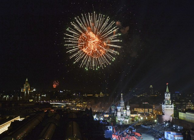 Fireworks explode over Red Square during the Victory Day celebrations in Moscow, Russia, May 9, 2015. (Photo by Reuters/Host Photo Agency/RIA Novosti)