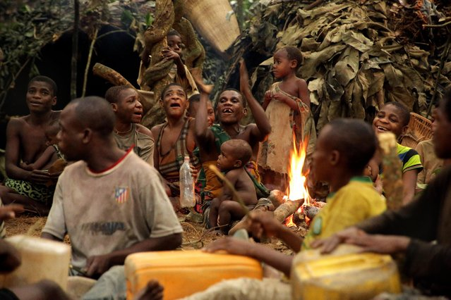 Ba'aka pygmies in their forest home, February 2016. Here, they enact their traditional hunting ceremony. (Photo by Susan Schulman/Barcroft Images)