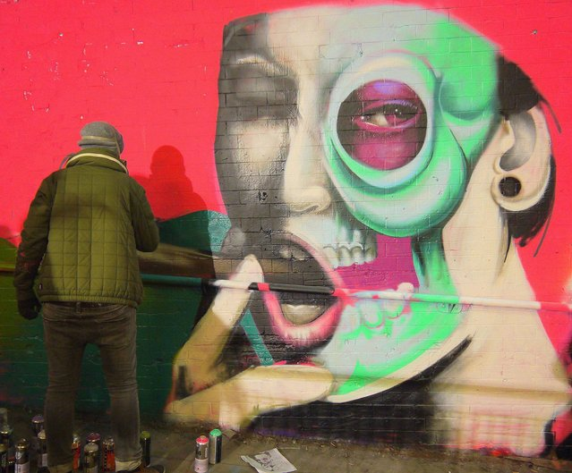 Graffiti of woman smoking a cigar, by CBLOXX. (Photo by Dez Mighty/Susan Mackey)