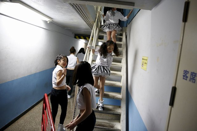 Dancers leave the backstage area before a Stardom female professional wrestling show at Korakuen Hall in Tokyo, Japan, December 23, 2015. (Photo by Thomas Peter/Reuters)