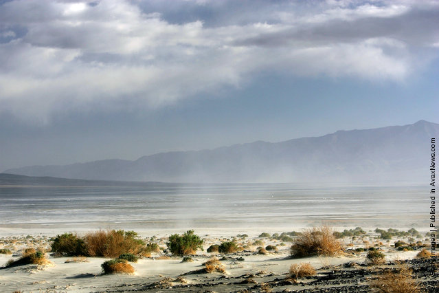 High winds blow sand across the highway near the original north shore of Owens Lake