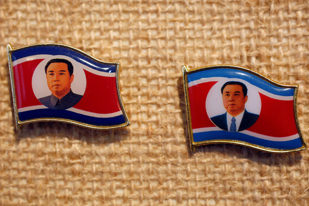 Two pins featuring former North Korean leader Kim Il Sung wearing different clothing are displayed in a glass case of Thomas Hui at his apartment in Hong Kong, China April 11, 2016. (Photo by Bobby Yip/Reuters)