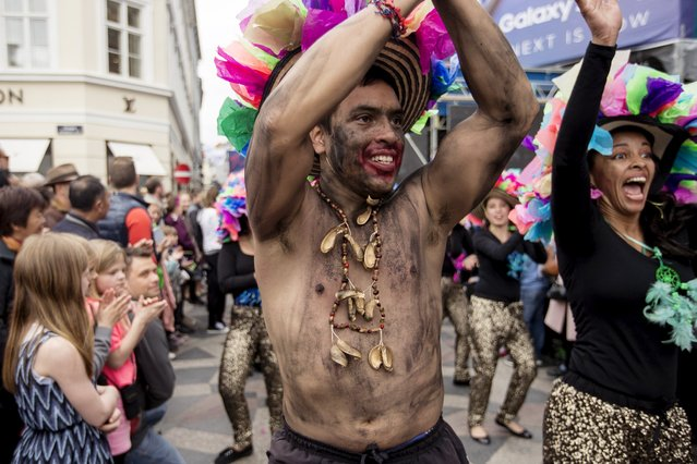 People take part in the Copenhagen Carnival parade May 23, 2015. (Photo by Jens Astrup/Reuters/Scanpix Denmark)
