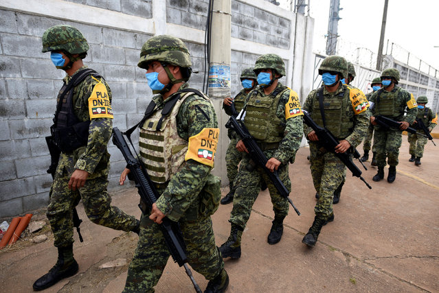 Soldiers wearing surgical masks patrol the perimeter of  Mexican national oil company Pemex's Pajaritos petrochemical complex in Coatzacoalcos, Veracruz state, Mexico, April 21, 2016. (Photo by Angel Hernandez/Reuters)