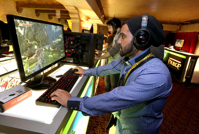 Gamers experience Fable Legends on Windows 10 at the Xbox-sponsored PC Gaming Show at E3 in Los Angeles on Tuesday, June 16, 2015. (Photo by Casey Rodgers/Invision for Microsoft/AP Images)
