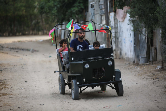 """Palestinian Ali Bannat, father of three children, injured twice in his foot due to Israeli soldiers' intervention during a protests within """"Great March of Return"""" demonstrations, drives a car made by himself from spare parts he collected to provide transportation at Al Bureij Refugee Camp in Gaza City, Gaza on June 08, 2019. Bannat did not recover despite 12 operations during treatment process. (Photo by Hassan Jedi/Anadolu Agency/Getty Images)"""
