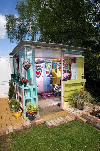 Ilona's Summerhouse – owned by Ilona in North Lincolnshire Hand crafted by a first-time builder with recycled materials of pallets, doors, polycarbonate roof and reclaimed paving slabs, this shed is a little sunlit hideaway. (Photo by Cuprinol/Rex Features/Shutterstock)