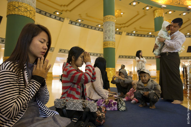 Burmese pray at the Ouparta Thandi pagoda which was built to mirror the famous  Shwedagon pagoda