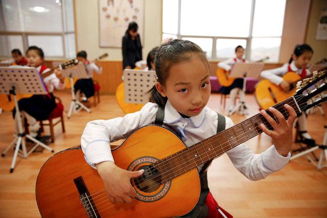Girls play guitars at the Mangyongdae Children's Palace in central Pyongyang, North Korea May 5, 2016. (Photo by Damir Sagolj/Reuters)
