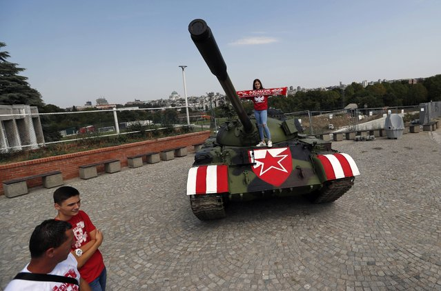 Former Yugoslav army T-55 battle tank seen in front of northern grandstand of Rajko Mitic stadium in Belgrade, Serbia, Tuesday, August 27, 2019, placed as a gesture of support for the Red Star team. The decommissioned Yugoslav army tank once used during the bloody breakup of former Yugoslavia in 1990s, has been parked in front of the Red Star stadium before Tuesday's Champions League qualifier against Swiss champion Young Boys. (Photo by Darko Vojinovic/AP Photo)