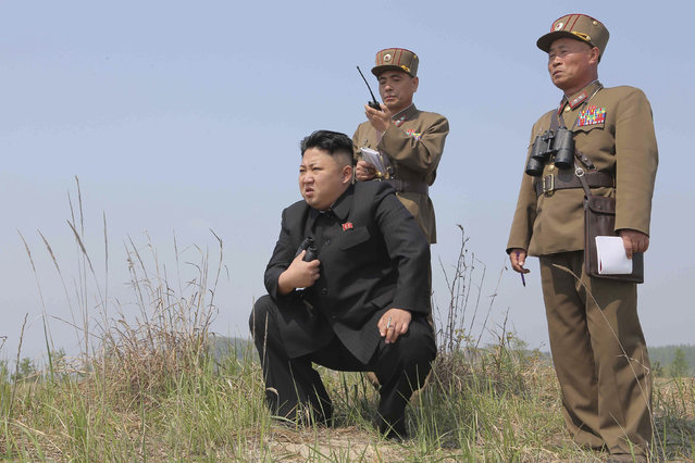 North Korean leader Kim Jong Un (C) guides the multiple-rocket launching drill of women's sub-units under KPA Unit 851, in this undated photo released by North Korea's Korean Central News Agency (KCNA) April 24, 2014. (Photo by Reuters/KCNA)
