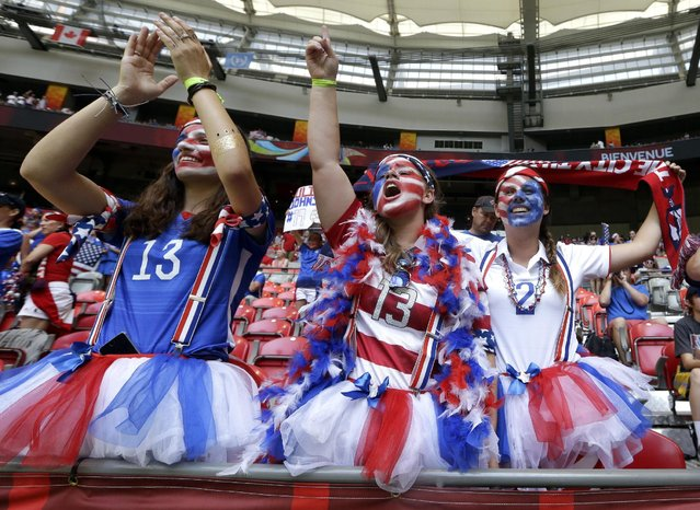 United States fans cheer before the FIFA Women's World Cup soccer championship between the U.S. and Japan in Vancouver, British Columbia, Canada, Sunday, July 5, 2015. (Photo by Elaine Thompson/AP Photo)