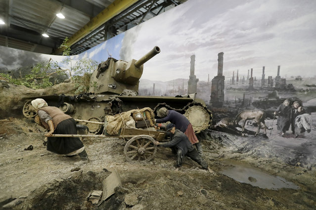 """A scene showing Russian refugees fleeing after a battle during World War II is prepared for the opening of the 3D Panorama exhibition """"Memory talks. The road through war"""" in the former Sevcabel port in St. Petersburg, Russia, 16 September 2019. (Photo by Anatoly Maltsev/EPA/EFE)"""
