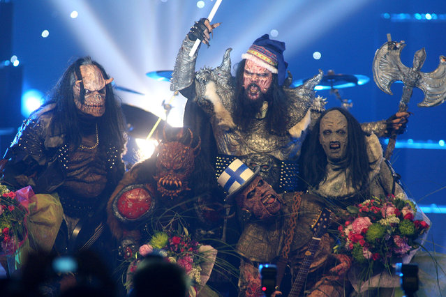 "In this early Sunday, May 21, 2006 file photo, Finnish group Lordi celebrate after their victory in the Eurovision Song Contest at the Indoor Olympic stadium in Athens, Greece. The annual competition had never seen anything like Lordi, who won with their song ""Hard rock hallelujah"". It's unlikely there will be any band quite like Lordi at this year's event in the Swedish capital Stockholm, the final of which takes place on Saturday, May 14. (Photo by Petros Giannakouris/AP Photo)"
