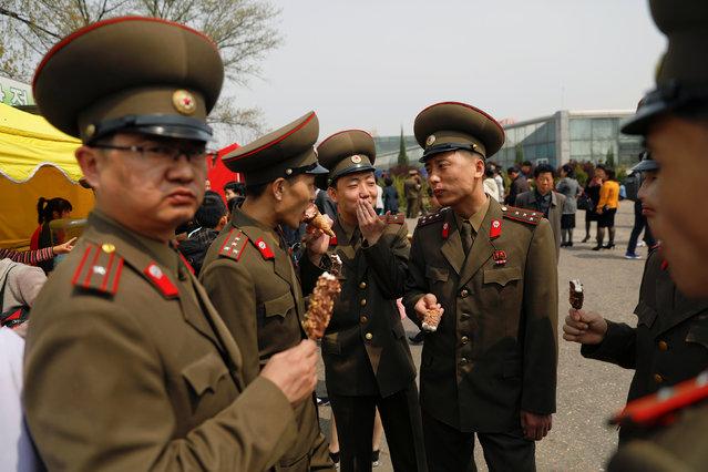 Soldiers enjoy ice-cream in central Pyongyang, North Korea April 16, 2017. (Photo by Damir Sagolj/Reuters)