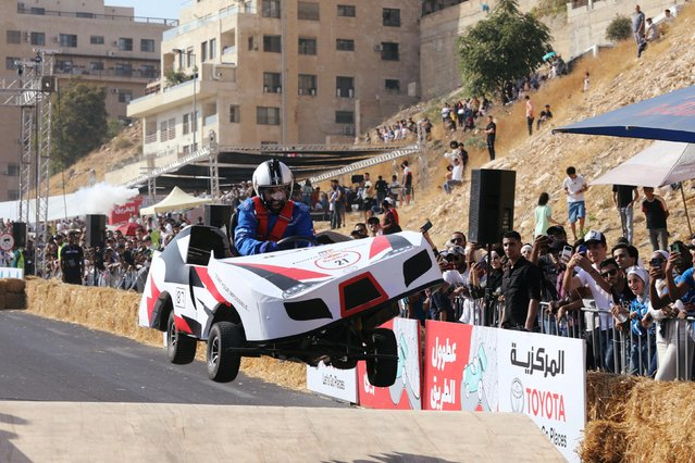 A competitor drives his homemade vehicle without an engine during the Red Bull Soapbox Race in Amman, Jordan on September 20, 2019. (Photo by Muhammad Hamed/Reuters)