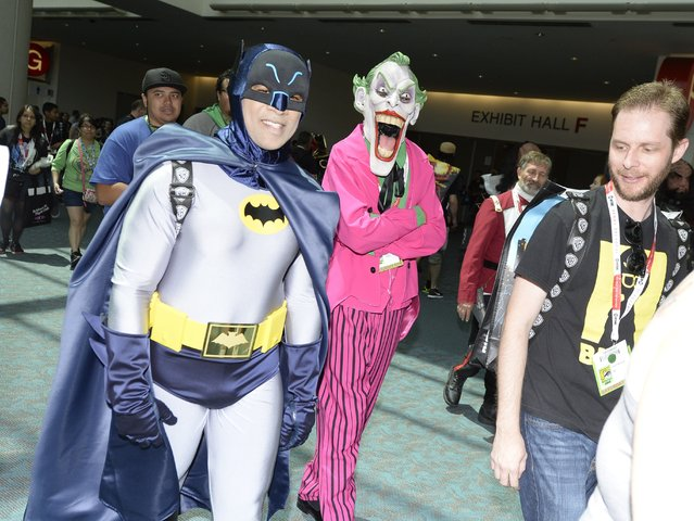 Cosplayers in Batman and Joker costumes attend the third day of Comic Con International in San Diego, California, July 11, 2015. (Photo by Robyn Beck/AFP Photo)