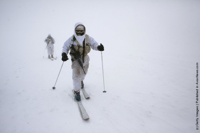 Israeli army alpine soldiers ski near their outpost during an exercise