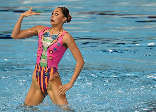 A member of team Mexico competes during the Synchronized Swimming Team Finals at the Toronto 2015 Pan American Games in Toronto, Canada July 11, 2015. Canada won the gold medal. (Photo by Timothy A. Clary/AFP Photo)