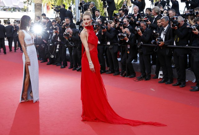 "Model Rosie Huntington-Whiteley poses on the red carpet as she arrives for the screening of the film ""La fille inconnue"" (The Unknown Girl) in competition at the 69th Cannes Film Festival in Cannes, France, May 18, 2016. (Photo by Yves Herman/Reuters)"