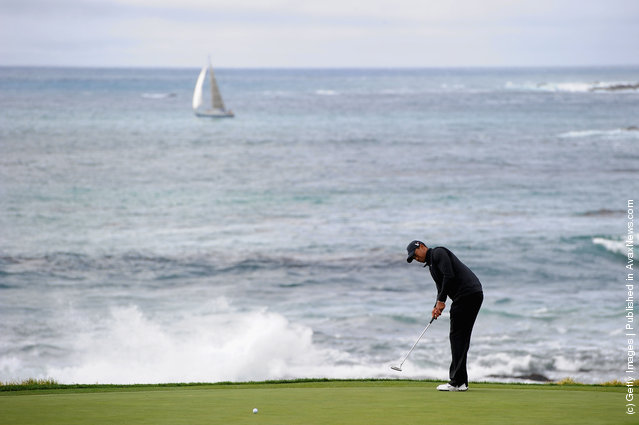 Tiger Woods putts on the ninth green during the third round of the AT&T Pebble Beach National Pro-Am at Pebble Beach Golf Links
