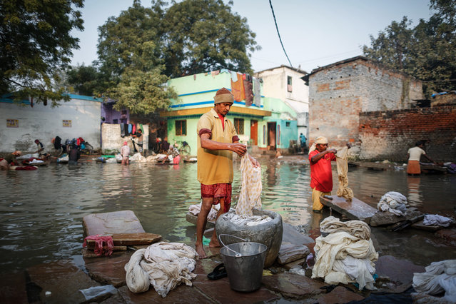"""Human Laundry"". Laundry Man wash their client cloths at the share pond in Varanasi. Photo location: India. (Photo and caption by Jeffry Lim/National Geographic Photo Contest)"