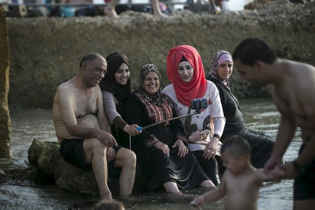 A Palestinian family takes a selfie on a beach of the Mediterranean in Tel Aviv during Eid al-Fitr, which marks the end of the holy month of Ramadan July 19, 2015. (Photo by Baz Ratner/Reuters)