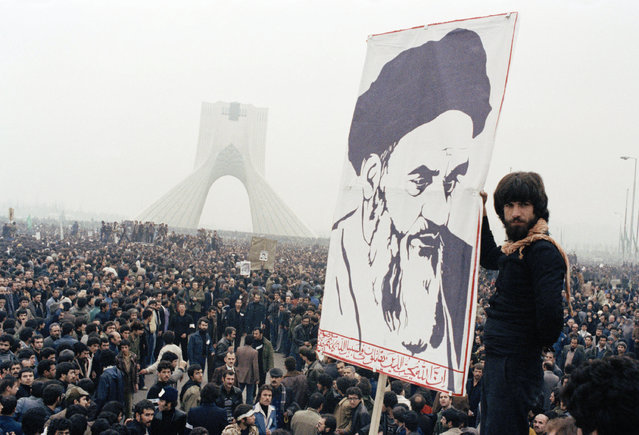 In this October 9, 1978 file photo, Iranian protesters demonstrate against Shah Mohammad Reza Pahlavi in Tehran, Iran. Forty years ago, Iran's ruling shah left his nation for the last time and an Islamic Revolution overthrew the vestiges of his caretaker government. The effects of the 1979 revolution, including the takeover of the U.S. Embassy in Tehran and ensuing hostage crisis, reverberate through decades of tense relations between Iran and America. (Photo by AP Photo/File)