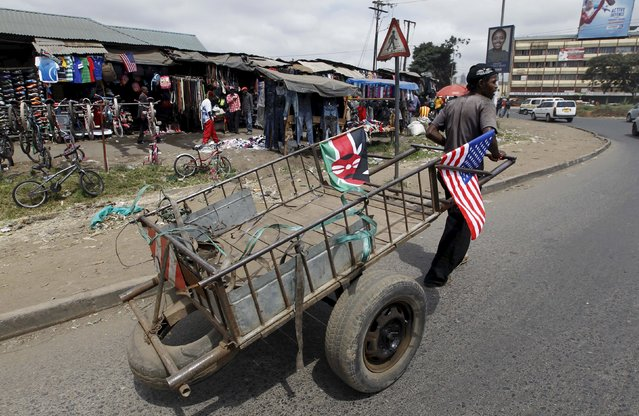 A man pulls an empty hand-drawn cart decorated with U.S. and Kenyan flags along a road ahead of a scheduled state visit by U.S. President Barack Obama, in Kenya's capital Nairobi July 24, 2015. (Photo by Thomas Mukoya/Reuters)