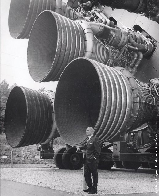 In this handout from NASA/Marshall Space Flight Center. Dr. Wernher von Braun stands next to F-1 Engines of the Saturn V launch vehicle