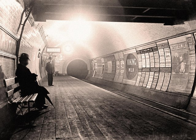 A man sits waiting for a train on the London Underground in 1890, when the platform floors were still made from wooden floorboards. (Photo by Hi-Story/Alamy Stock Photo)