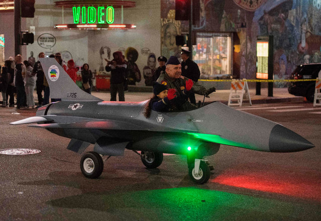 A model plane drives past during the 88th annual Hollywood Christmas Parade in Hollywood, California on December 1, 2019. (Photo by Mark Ralston/AFP Photo)