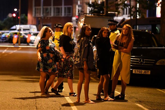 """Women stand at a police cordon set up in London on June 4, 2017 following a terrorist attack on London Bridge and Borough Market. Armed police opened fire during what they described as a """"terrorist"""" attack in central London Saturday after reports of stabbings and a van ploughing into pedestrians just days ahead of a general election. (Photo by Justin Tallis/AFP Photo)"""