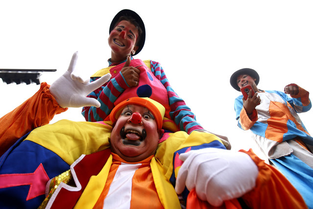 Clowns pose for a picture during the International Clown Day in Guadalajara, Mexico, on December 10, 2019. (Photo by Ulises Ruiz/AFP Photo)