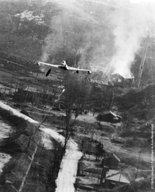 A US F-80 Shooting Star making a low-level attack with a napalm bomb on a storage centre at Suan, south-east of P'yongyang, during the Korean War, 1952