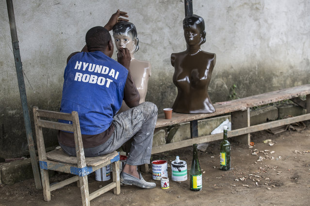 In order to witness the whole process Choumali ordered several mannequins and asked to document their production. The models are handmade from polyester and oil paint, with each designed and coloured according to client requests. The make-up of each is also carefully hand-painted. Here: Mr Sidibé works on the faces of his mannequins. (Photo by Joana Choumali)