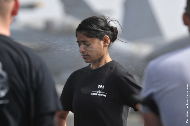 Operations Specialist 2nd Class Jenna Rainbolt, temporarily assigned to the security department aboard the Nimitz-class aircraft carrier USS Carl Vinson (CVN 70), is sprayed with Oleoresin Capsicum (OC) spray during security academy OC spray qualifications