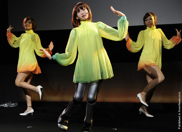 "HRP-4C, a five-foot humanoid robot developed at Japan's National Institute of Advanced Industrial Science and Technology, sings and dances with performers at the Digital Contents Expo in Tokyo on October 17, 2010. The robot runs entertainment software called Choreonoid, a name formed from the words ""choreograph"" and ""humanoid"""