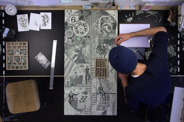 Mark Wagner in his Brooklyn studio at work on a new collage. (Photo by Mark Wagner)