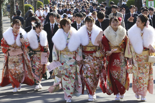 Kimono-clad women who celebrate turning 20 years old walk together following a Coming-of-Age ceremony at Toshimaen amusement park in Tokyo, on Coming of Age Day, Monday, January 13, 2020. Held annually on the second Monday of January, Coming of Age Day is a special time for these young adults. (Photo by Koji Sasahara/AP Photo)