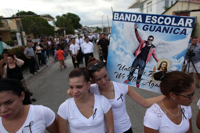 Members of a school band perform during the funeral of Angel Candelario, one of the victims of the shooting at the Pulse night club in Orlando, after he was flown in from Florida to be buried, in his hometown of Guanica, Puerto Rico, June 17, 2016. (Photo by Alvin Baez/Reuters)