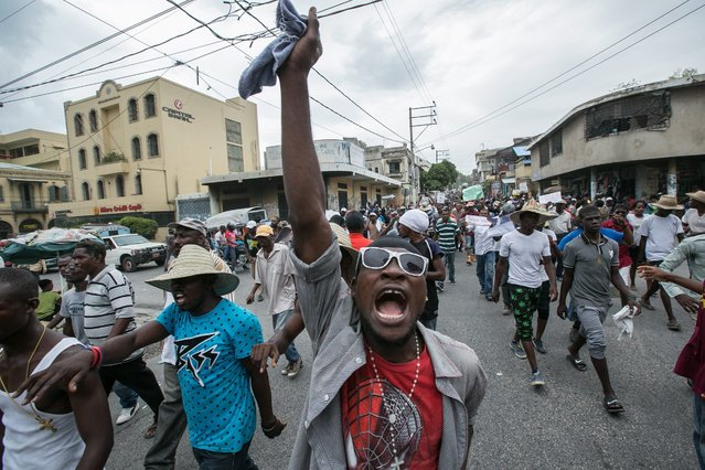 Protesters take to the streets in support to the extension of acting President Jovelerme Privert's term, in Port-au-Prince, Haiti, 21 June 2016. The Haitian Parliament has not reached an agreement on the extension of acting President of Haiti Jocelerme Privert's term, which started in February pending a general election in no more than 120 days, nor the appointing of another interim leader, as hundreds of people took the streets supporting Privert. (Photo by Bahare Khodabande/EPA)