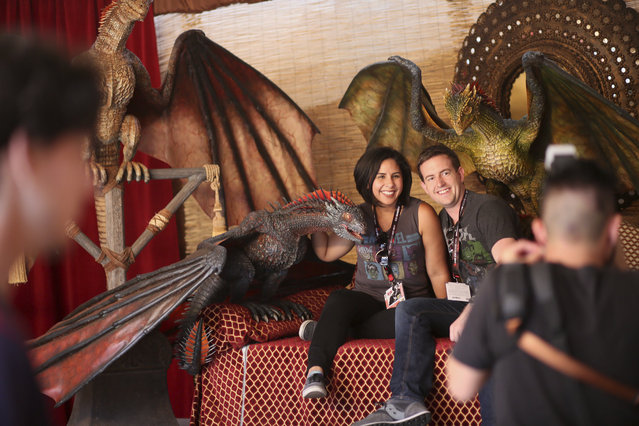 Attendees have their photo taken in a Game of Thrones set at Xfinity's TV Diner featuring sets and food inspired by Game of Thrones, Orange is the New Black, and Marvel's Luke Cage at Comic Con International in San Diego, CA on Wednesday, July 19, 2017. (Photo by Sandy Huffaker/AP Images for Xfinity)