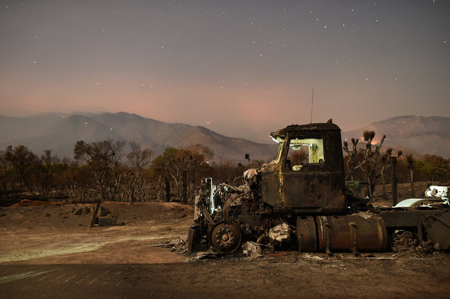 A burned out truck rests on a roadside after the Erskine Fire burned through Weldon, California, U.S. June 26, 2016. (Photo by Noah Berger/Reuters)