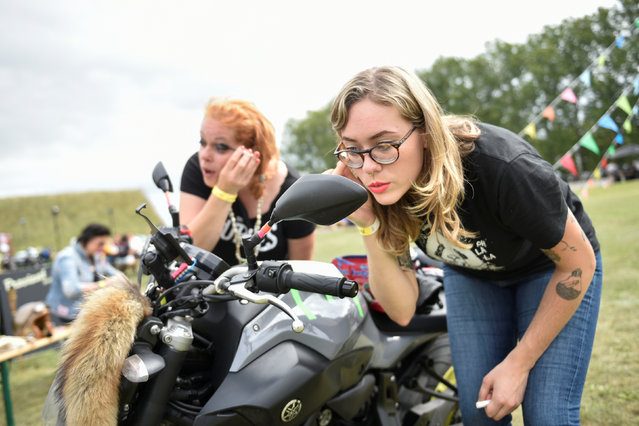 Participants prepare for a motorbike ride out at the women-only Petrolettes motorcycle festival in Neuhardenberg near Berlin, Germany on July 29, 2017. (Photo by Stefanie Loos/Reuters)