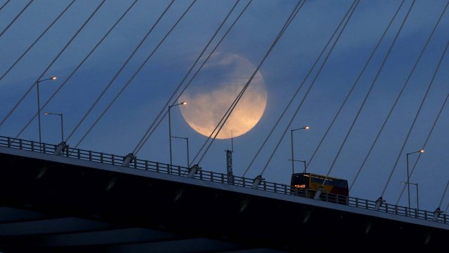 The Supermoon rises over a bridge in Hong Kong. (Photo by Kin CheungAssociated Press)